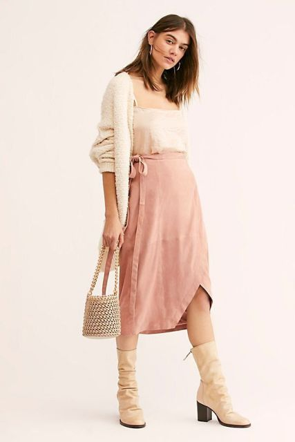 With beige top, cardigan, bag and beige low heeled boots