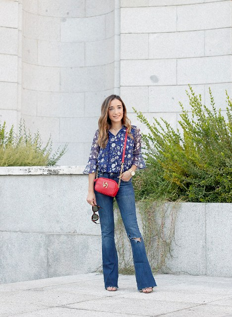 With bell sleeved blouse, red bag and high heels