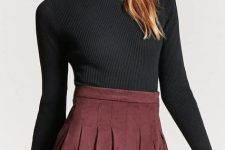 With black cap and black turtleneck