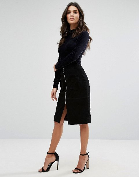 With black long sleeved shirt and black ankle strap high heels