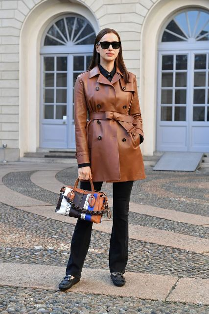 With black shirt, black flare pants, colorful bag and flat shoes