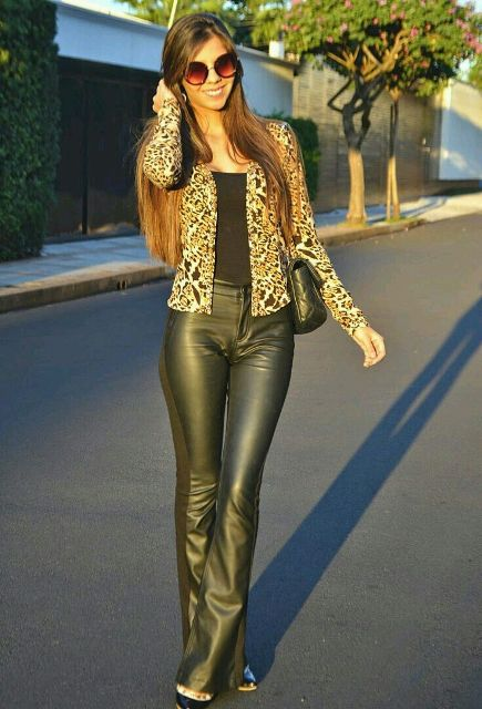 With black top, black bag, pumps and leopard cardigan