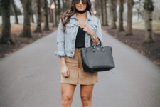With black top, denim jacket, black bag and gray suede ankle boots