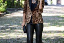 With black top, leopard blazer and black clutch