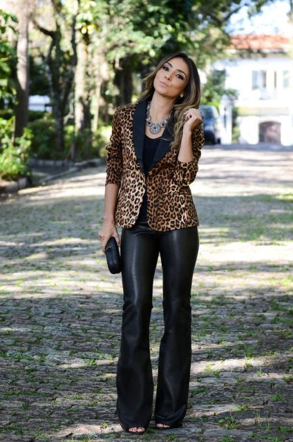 With black top, leopard blazer and black clutch