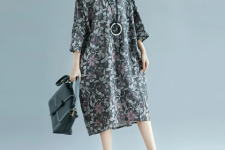 With black tote bag and beige and brown flat shoes