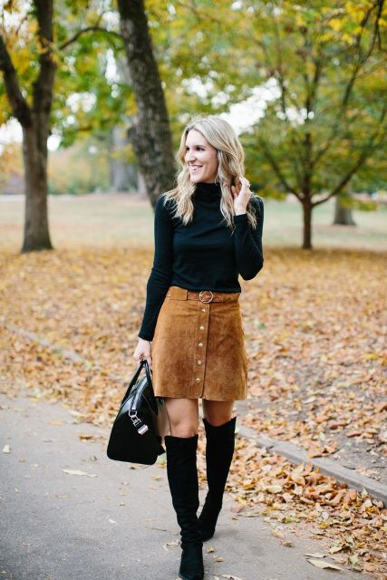 With black turtleneck, black leather bag and over the knee boots