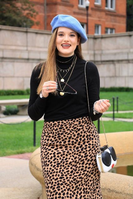 With black turtleneck, leopard printed skirt and unique bag
