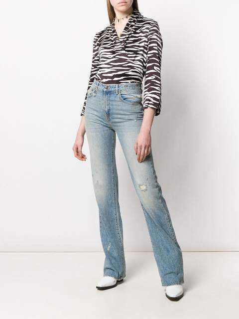 With brown and white printed wrap blouse and white boots