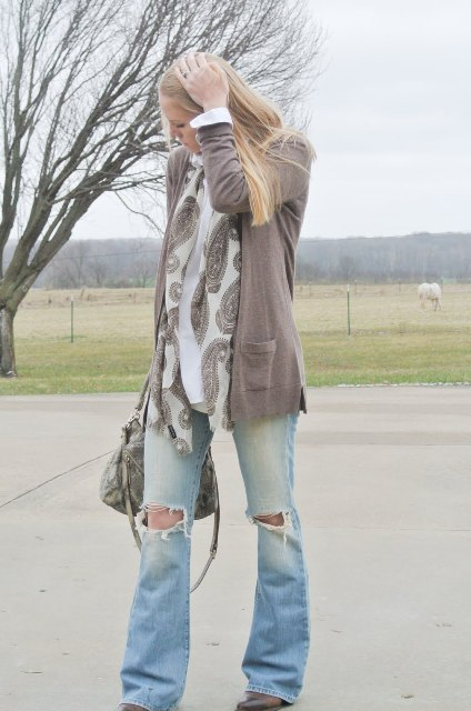 With cardigan, boots, gray bag and printed scarf