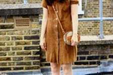 With crossbody rounded bag and brown heeled shoes
