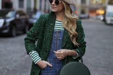 With denim jumpsuit, striped shirt, green coat and green rounded bag