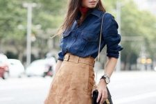 With denim shirt and chain strap bag