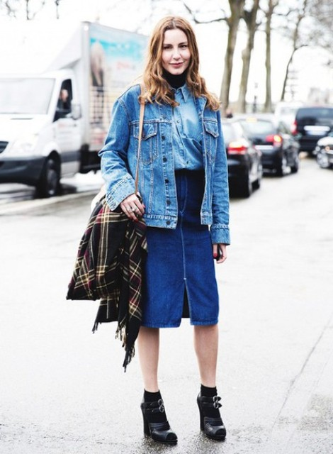 With denim shirt, denim jacket, black heeled shoes and beige bag