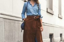 With denim shirt, skinny jeans, lace up high heels and blue bag