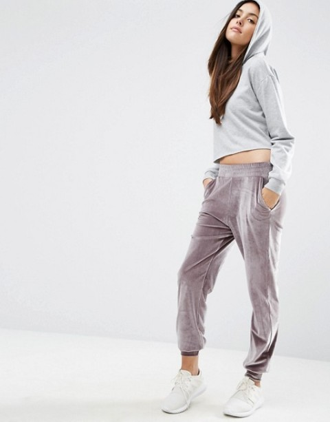 With gray crop hoodie and white sneakers