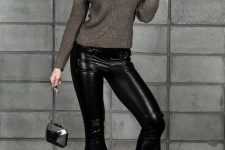 With gray cutout sweater, silver bag and boots