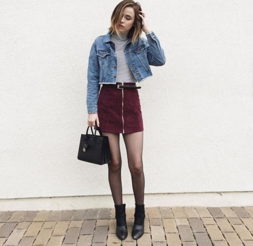 With gray turtleneck, denim crop jacket, black bag and ankle boots