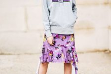 With hoodie, floral skirt and lilac pumps