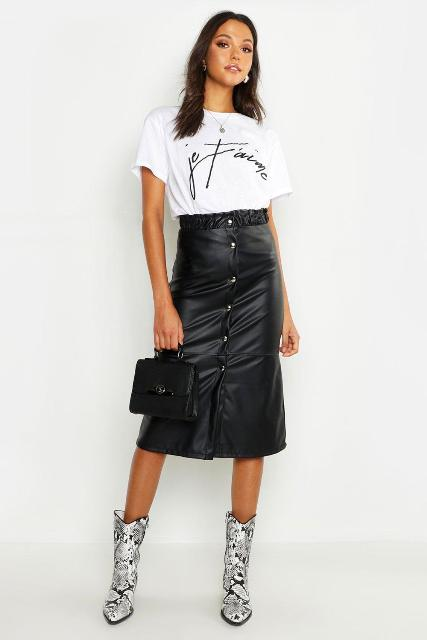 With labeled t-shirt, black mini bag and snake printed boots