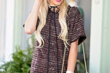 With leopard printed chain strap bag, over the knee boots and sunglasses