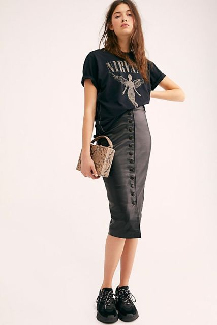 With loose t-shirt, snake printed bag and black sneakers