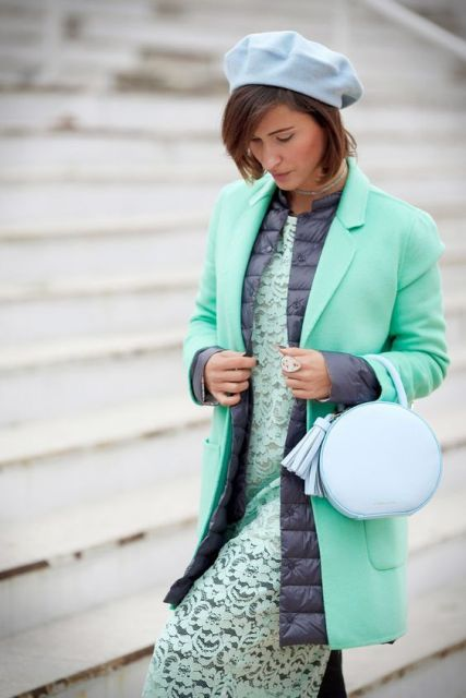 With mint green lace midi dress, rounded leather bag and mint green coat