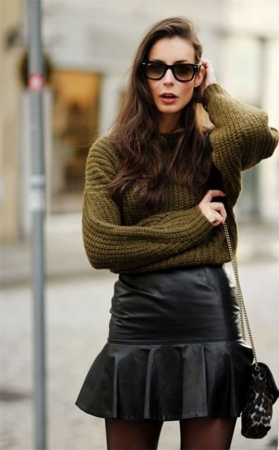 With olive green sweater and printed chain strap bag