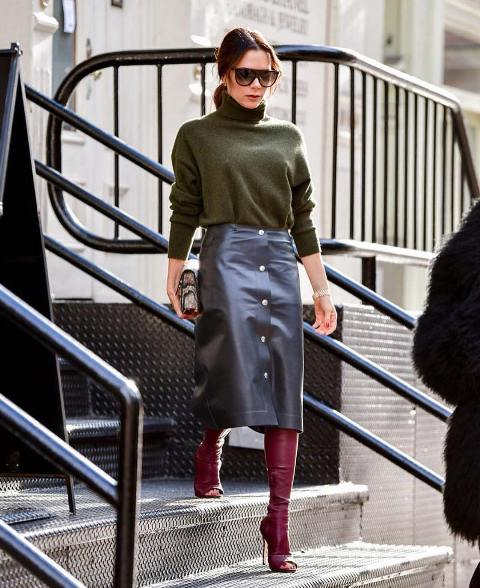 With olive green turtleneck, printed clutch and purple cutout high boots