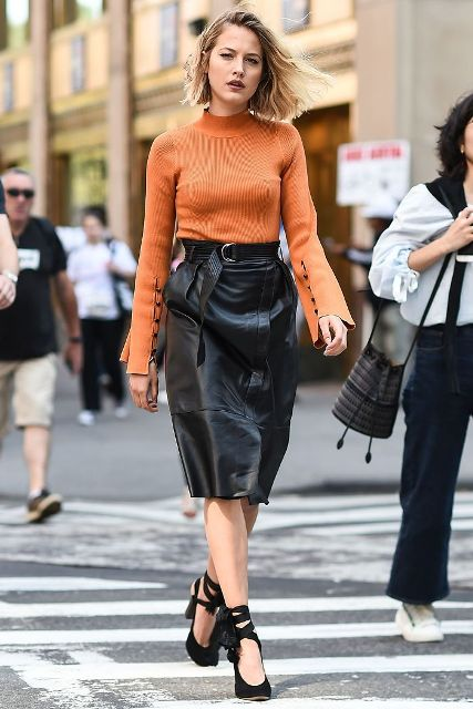 With orange bell sleeved shirt and black lace up high heels