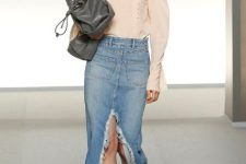 With pale pink blouse, gray bag and black mules