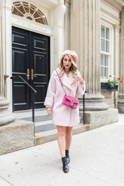 With pale pink coat, black boots and pink crossbody bag