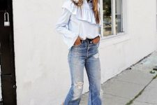 With ruffled blouse and white low heeled sandals