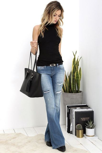 With sleeveless top, black tote bag and black boots