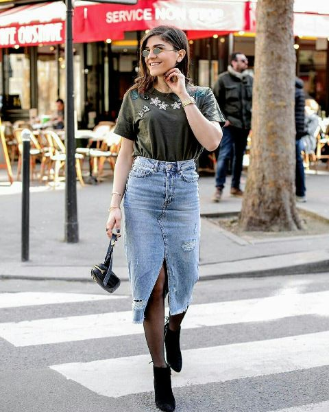 With t shirt, black ankle boots and mini bag