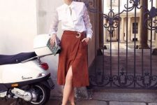 With white blouse, printed clutch and ankle strap shoes