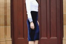 With white button down shirt and black pumps