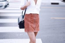 With white button down shirt, black bag and brown suede fringe shoes