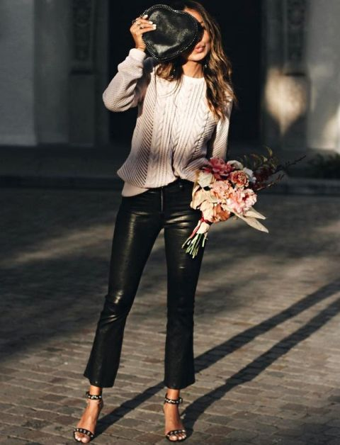 With white loose sweater, bag and embellished shoes