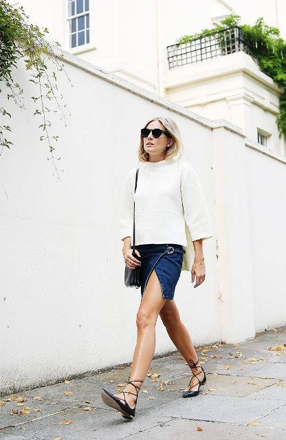 With white loose sweatshirt, black bag and black lace up flat shoes