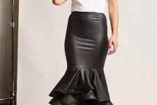 With white one shoulder top and black ankle strap high heels