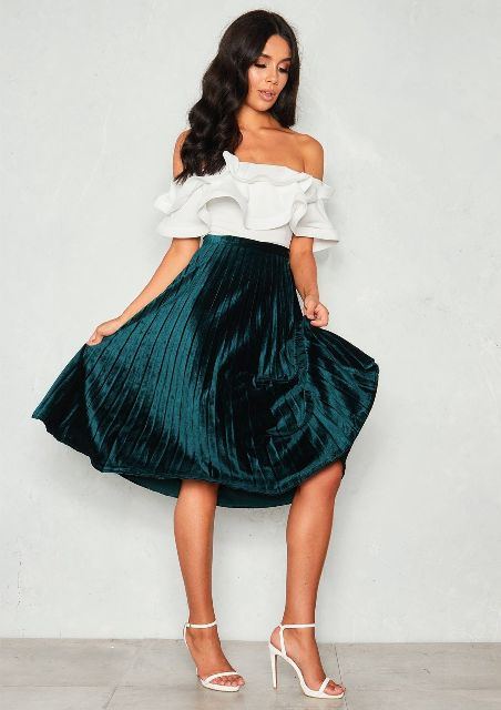 With white ruffled off the shoulder top and white ankle strap high heels