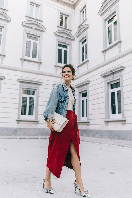 With white shirt, denim jacket, white clutch and printed pumps