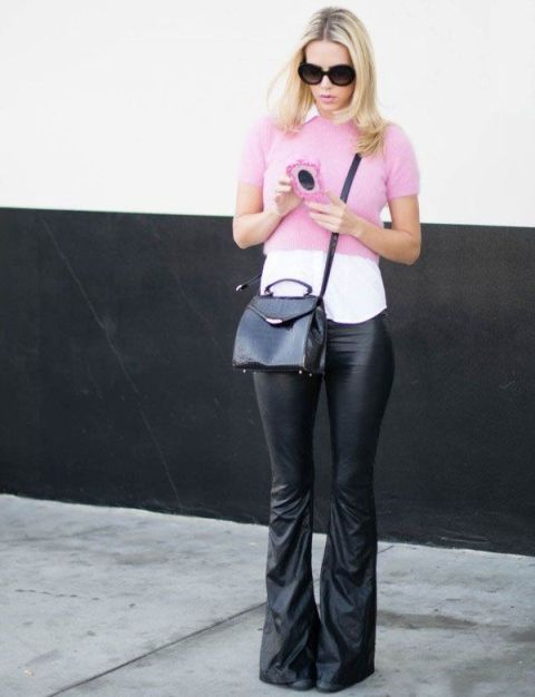 With white shirt, pale pink crop sweater, black bag and boots