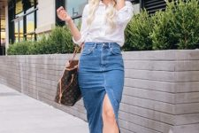 With white shirt, printed tote bag and leopard flat shoes