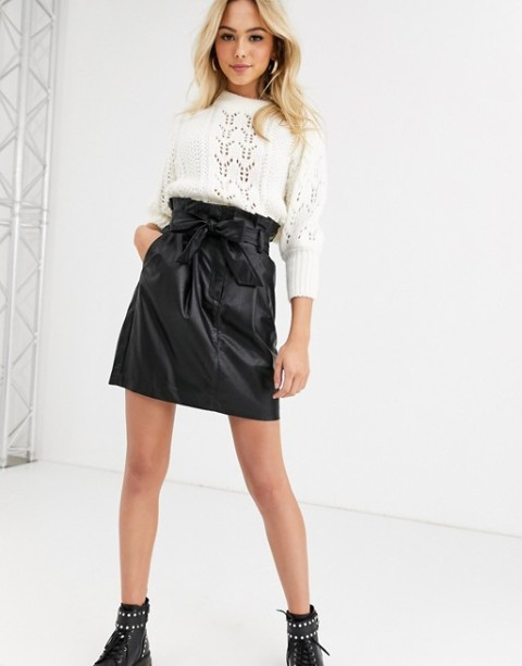 With white sweater and black flat boots