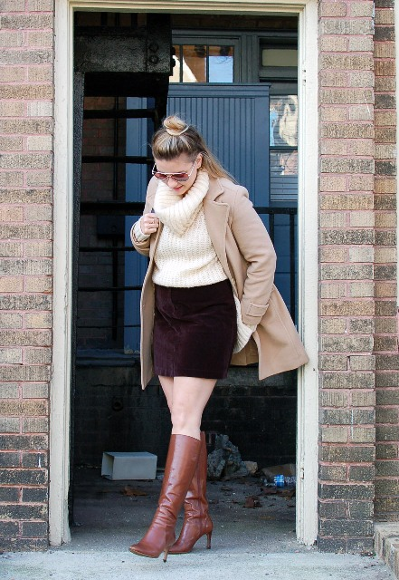 With white sweater, beige coat and brown leather high boots