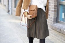 With white sweater, brown jacket, suede boots and bag