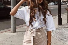 With white t-shirt and beige bag