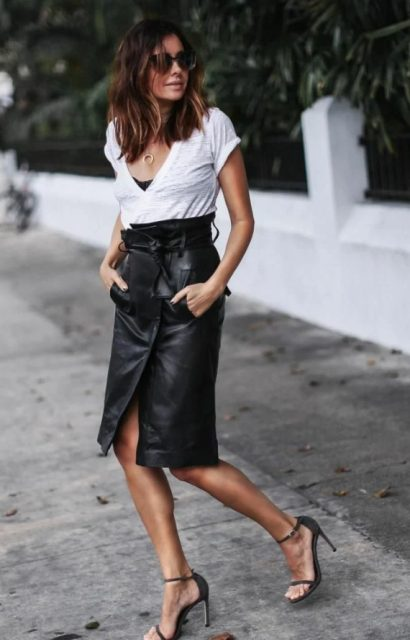 With white t-shirt and black ankle strap high heels